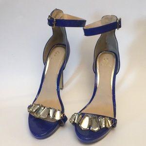 Blue heels with rhinestone piece across foot